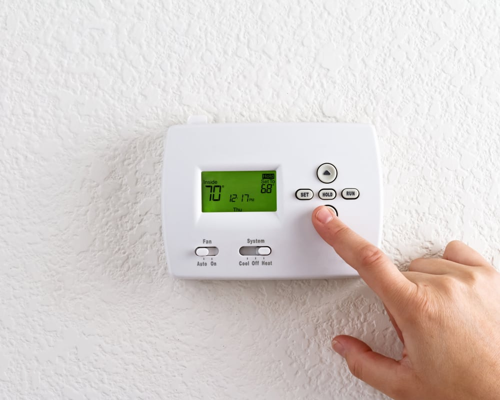 What type of thermostat should I use at my Alton Illinois home?