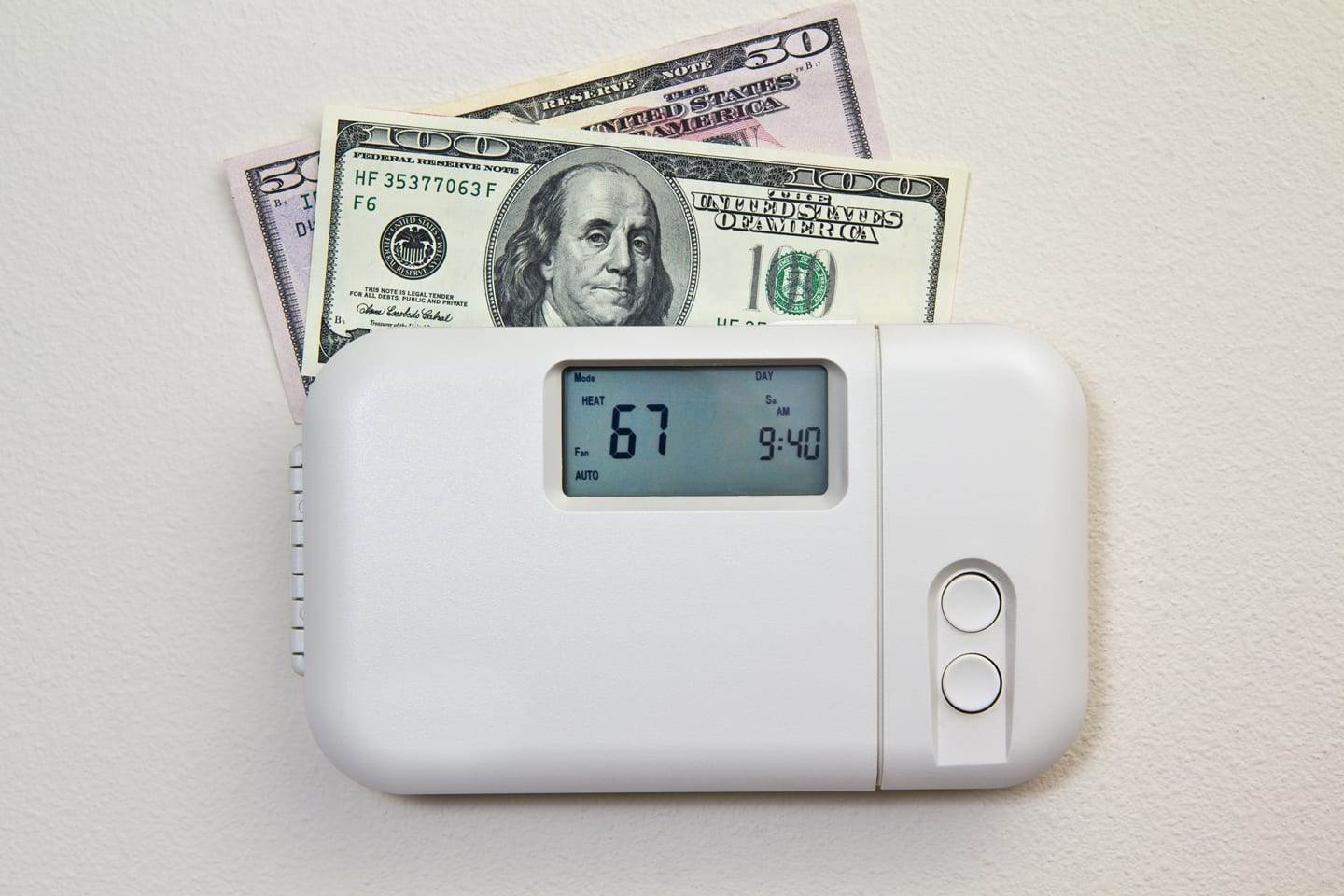 thermostat settings for lower energy bills in Edwardsville Illinois